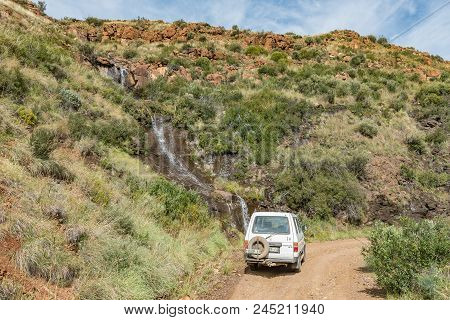 Lady Grey, South Africa - March 29, 2018: A Vehicle At A Waterfall In The Historic Jouberts Pass At