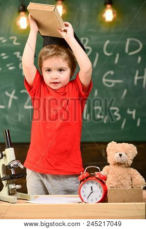 Child, Pupil On Cheerful Face Near Microscope. Wunderkind Concept. First Former Interested In Studyi