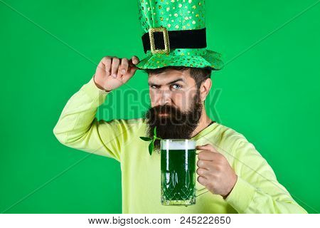 St. Patrick's Day. Bearded Man In Leprechaun Hat. Portrait Of Pensive Man With Green Beer. Bearded L