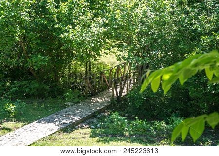 Zeda-gordi, Georgia. View Of Paved Forest Path And Wooden Bridge Leading To Canyon Okatse