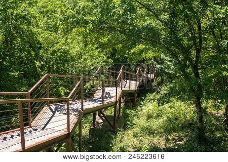 Narrow Suspension Bridge Or Pendant Road On Territory Okatse Canyon, Georgia