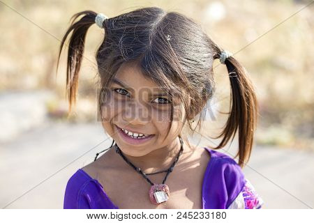 Mandu, India - February 03, 2017 : An Unidentified Indian Girl Child Begging For Money From Tourists