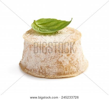 Crottin Cheese With Basil Leave Isolated On White Background