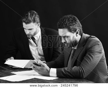 Success, Partnership, Start Up. Busy People Read Documents And Look At Smartphone. Business Partners