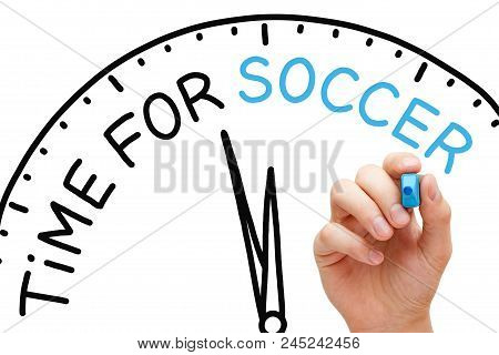 Hand Writing Time For Soccer Concept With Blue Marker On Transparent Wipe Board.