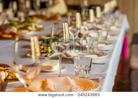 Crystal Wine Glasses And A Glass For Juice On The Banquet Table