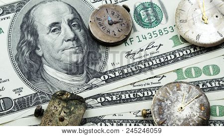 Old Clock On The Background Of Money, Dollars. Time Is Money. Money Takes Time. Money Devours Time.