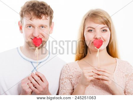 Quietly About Love And Feelings. Lovely Charming Blonde Female And Male Lovers Covering Their Mouth