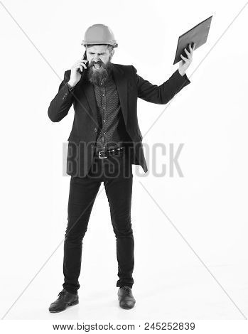 Angry Inspector Concept. Angry Inspector Holds Business Plan And Shouts While Talking On Phone.