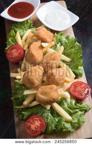 Deep fried and breaded chicken nuggets, american meal served as dinner or fast food meal