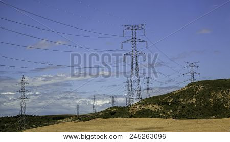 Electric Towers In A Landscape