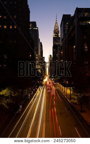 Congested traffic at night on 42nd street in New York city known as Manhattanhenge poster