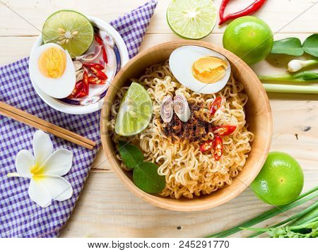 Instant Noodles In Ceramic Cop And Vegetable Side Dishes On Wood Background