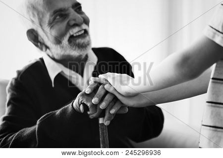 Grandson holding his grandpa's hands poster