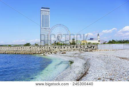 Osaka , Japan - May 10 , 2018 : Artificial White Marble Beach Along The Shoreline Of Rinku Town View
