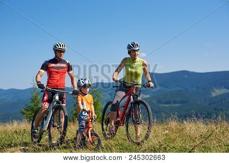 Verkhovyna, Ukraine - August 19, 2017: Photo Of Modern Sportive Tourist Family, Mom, Dad And Small C