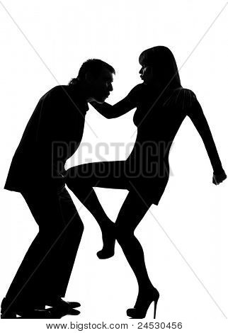 one caucasian couple man and woman self defense  domestic violence in studio silhouette isolated on white background