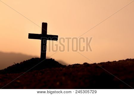 The Cross On The Mountain Has The Sunset As The Background., Concept For Christian, Christianity, Ca