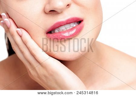 Woman suffers from strong tooth pain, isolated on white background