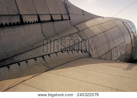 Fuselage Detail View. Airplane Metallic Fuselage Detail With Rivets. Old Silver Metal Surface Of The