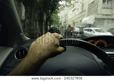 Driving A Car On A Rainy Day. Rainy Day In The Car. Rain Drops On The Car Glass.driving. Hand Holdin