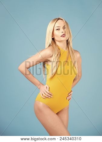 Girl In A Full Swimsuit. Sensual Woman With Blond Hair, Makeup. Sensual Woman With Happy Face And Bl
