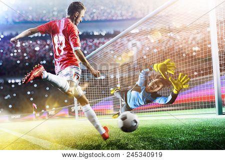 Goalkeeper Catches The Ball On The Football Stadium