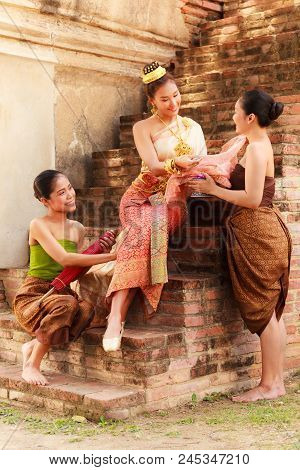 Asian Noble Beauty With Maids Dressed In Traditional Clothes Shopping In Old Retro Historical Period