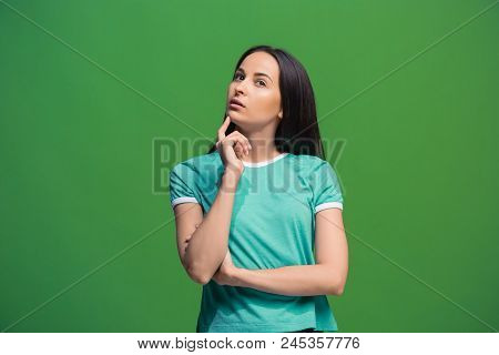 Let Me Think. Doubt Concept. Doubtful Pensive Woman With Thoughtful Expression Making Choice. Young