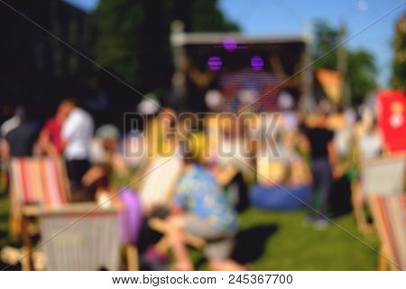 Summer Festival. Festive Urban Blurred Background With People.
