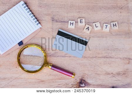 Stethoscope ,magnfying And Book Note On Wood