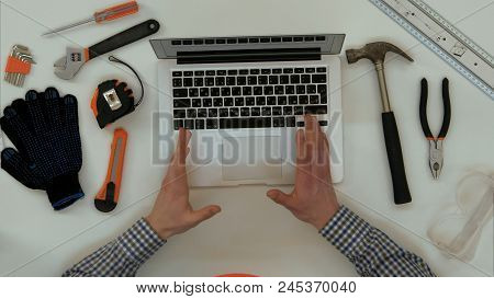 Engineer Explaining Technical Drawing During Video Call On Laptop. Close