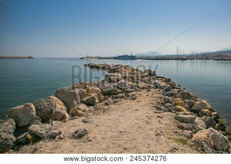 Harbor And Lighthouse Of The City Of Rethymno In In Crete Greece