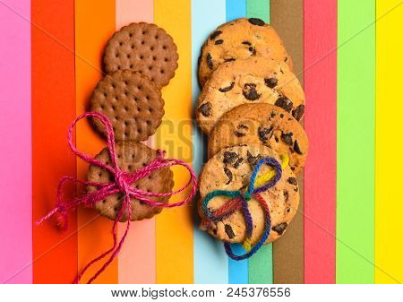 Homemade And Consumer Cookies On Colorful As Rainbow Background. Biscuits Concept. Biscuits Bought O