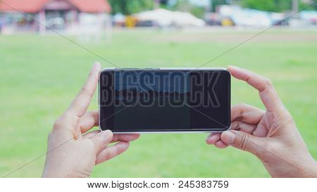 Hand Of Women Holding Smartphone To Take Photo About Outdoor Market It For Technology, Internet, Com
