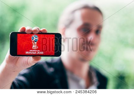 Cologne, Germany - May 06, 2018: Closeup Of Young Man Holding White Iphone With Worldcup 2018 Logo O