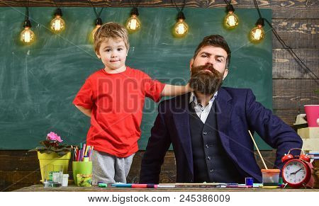 Teacher With Beard, Father And Little Son Having Fun In Classroom, Chalkboard On Background. Child C