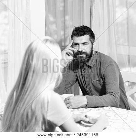 Morning Date Concept. Couple In Love Holds Cups Of Coffee At Table. Woman And Man With Interested Fa