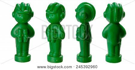 Set Of Four Antique Toy Plastic Soldiers With Tankmen In A Helmet And With Binoculars Isolated On A