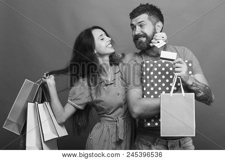 Shopping And Fashion Concept. Bearded Man Holds Credit Cards. Couple In Love With Happy Faces Hugs,