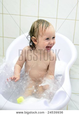 Little Girl Having Fun In The Bathroom