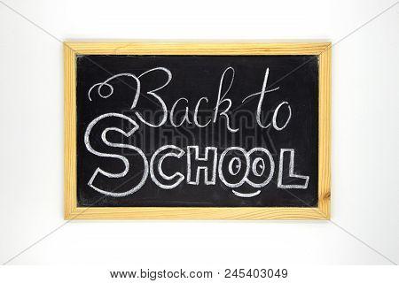 Back To School Chalk Lettering On Blackboard. White Chalk Back To School Inscription On Chalkboard.