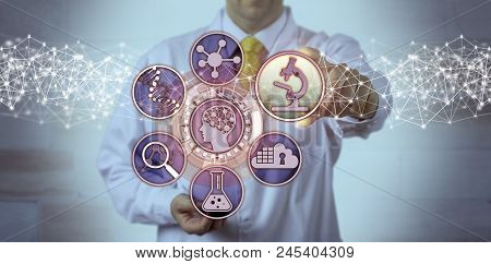 Unrecognizable male scientist is plugging a microscopy app into a brain study interface. Science concept for biosciences, molecular engineering, bioengineering, pharmacogenomics, pharmacogenetics. poster