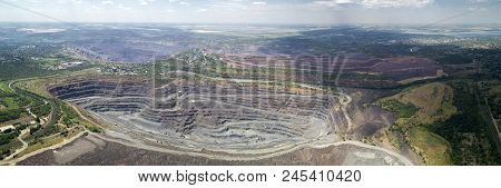 Aerial Panoramic View Of Opencast Mining Quarry With Lots Of Machinery At Work. Mining-dressing Quar