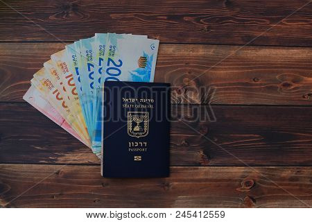 Preparing For A Trip, Mobile Phone, Money, Passport On Wooden Table.