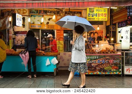 SEOUL, SOUTH KOREA-May 17, 2018: Woman shopping in the Namdaemun Market in South Korea,  the oldest and largest market in Korea.