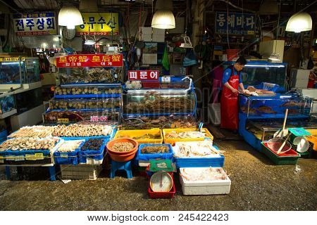 SEOUL-SOUTH KOREA, MAY 18, 2018:  Man at his stand at the fish market in south Korea.  Noryangjin Fish Market is an extensive farmers fish market in the neighborhood of Noryangjin-dong