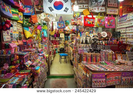 Colorful stand with bags, purse and souvenirs for sale into a Namdaemun Market in South Korea.  It is the oldest and largest market in Korea.