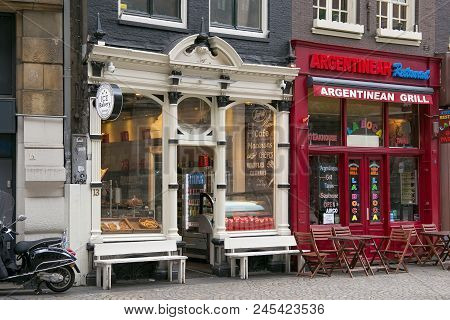 Amsterdam, Netherlands - June 25, 2017: Storefronts Of The Ice Bakery Cafe And Argentinean Steakhous