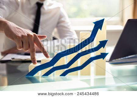 Businessperson's Finger Climbing Increasing Graph